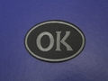 Термонаклейка черно-серая с надписью ОК